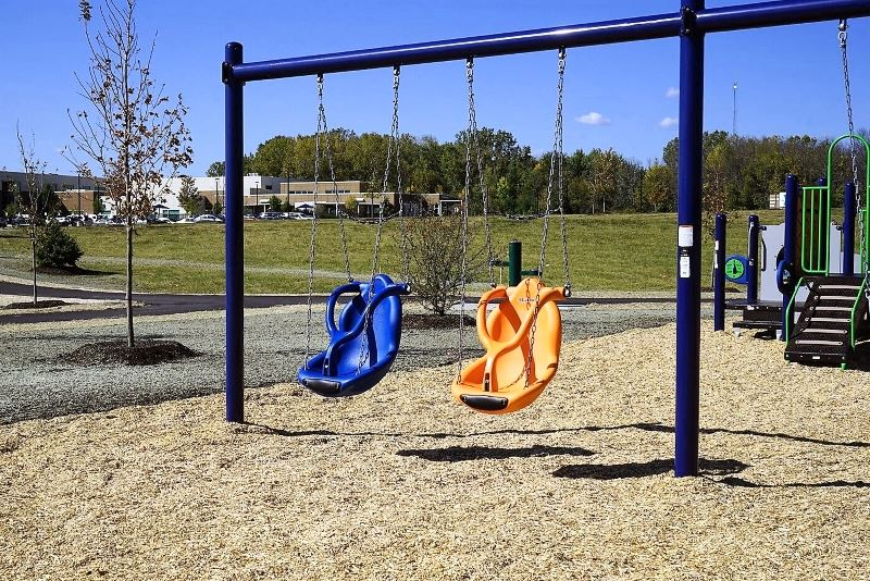 blue and orange swing at the Greenwood Family Playground